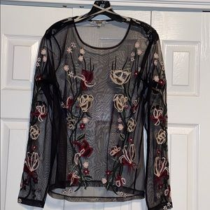 Mesh top with flower embroidery.